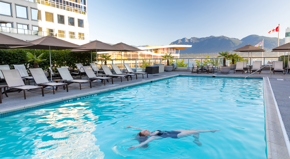 Guest enjoying the rooftop heated pool at the Fairmont Waterfront