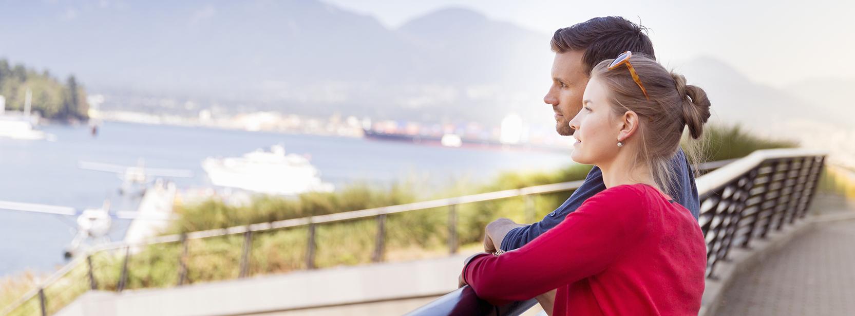 Man and women overlooking floatplanes in Vancouver harbour